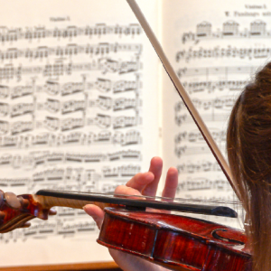 Violinist with a musical score